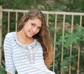 Rebel Lynn - thin teen lounging on the balcony 3