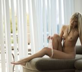Kenna James Strips On A Couch 3
