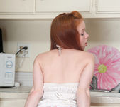 Dolly Little spreading her pussy in the kitchen 3