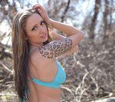 Lily posing in her aqua blue bikini 7