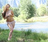Lily poses in Yosemite Park and teases in a sexy USA bikini 6