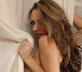 Lily wraps her naked body in the curtain 11