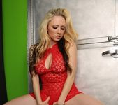 Lily poses in a sexy red dress 10