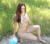 Lily plays with her blue ball naked 5