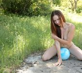 Lily plays with her blue ball naked 8