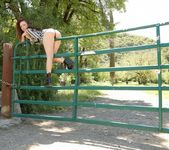 Lily poses and teases on the gate 7