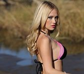 Shannyn shows her amazing body in the wet sand 5