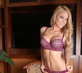 Shannyn strips and teases in her plum lingerie 7