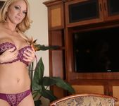 Shannyn strips and teases in her plum lingerie 14