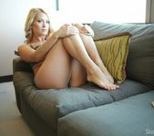 Shannyn strips on the couch 10