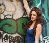 Hayden poses by graffiti 3