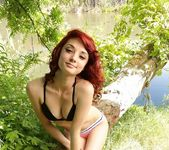 Kylie Cole strips by the tree 2