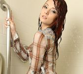 Kylie gets wet in the shower 9