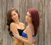 Kylie and Camryn have some fence fun 7