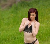 Kylie gets nude in the grass 8