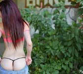 Kylie strips by the bush 8