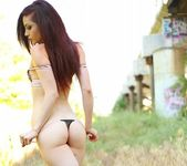 Kylie strips and teases in the field 9