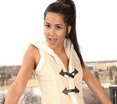 Bella poses in her cute vest 9