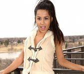 Bella poses in her cute vest 10