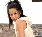 Bella poses in her cute vest 12