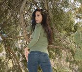 Bella teases and poses in the tree 6
