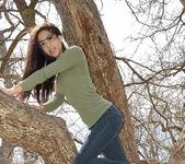 Bella teases and poses in the tree 9