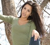 Bella teases and poses in the tree 10