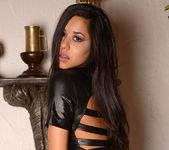 Bella strips out of her leather 6