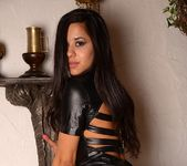 Bella strips out of her leather 7