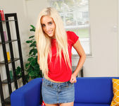 Naomi Woods touching herself on the sofa 2