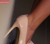 Carrie - blond in high heels fingering her puss 15