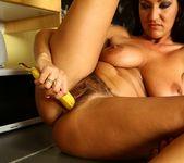 Christina Ventura - milf sticks a banana into her hairy puss 14