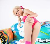 Elsa Jean poses in pigtails on the PUBA couch 5