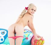 Elsa Jean poses in pigtails on the PUBA couch 13