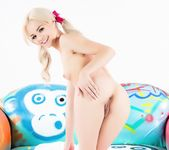 Elsa Jean poses in pigtails on the PUBA couch 14