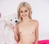 Elsa Jean spreads her pussy on a pink bed 3