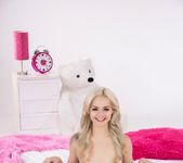 Elsa Jean spreads her pussy on a pink bed 6