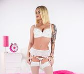 Pretty blonde Daisy Monroe poses in white lingerie 3
