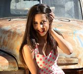 Bella strips in the junkyard 2