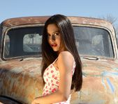 Bella strips in the junkyard 3