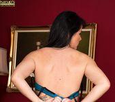 Curvy mature babe Danielle Leah Raven spread on the sofa 6