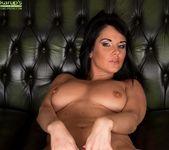 Curvy mature babe Danielle Leah Raven spread on the sofa 13