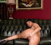Curvy mature babe Danielle Leah Raven spread on the sofa 15