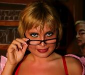 Blonde MILF in glasses shows off her shaved pussy 4