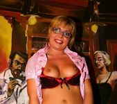 Blonde MILF in glasses shows off her shaved pussy 5