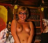 Blonde MILF in glasses shows off her shaved pussy 8