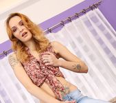Redhead babe Belle Claire toys her puffy pussy 2