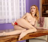Redhead babe Belle Claire toys her puffy pussy 14