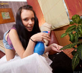 Alisa Cage - watering the plants and her pussy 3