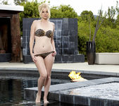 Charlotte Stokely Caresses Her Sexy Body At The Pool 2